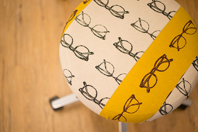 I refreshed this medical stool by reupholstering it with a fabric I found at a localshopand restyled it to make it more interesting.Photo appears courtesy of Andrew Wong photography .